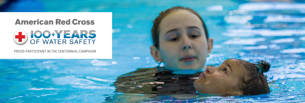 Photo of girl helping little girl swim in pool with American Red Cross 100 plus years of water safety centennial campaign logo