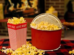 Photo of a popcorn popper and popcorn in a container